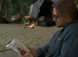Sawyer enjoys reading on the island... when he's not chasing boar or burying people alive. (accidentally)